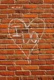 Kreide-geschrieben tue ich auf Backsteinmauer Stockfotografie