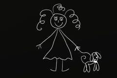 Kreide-Mädchen mit Hund Stockfoto