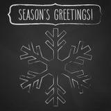 Kreide-Schneeflocke und Jahreszeit ` s Grüße Stockbilder