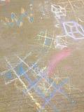 Kreidezeichnung auf Bürgersteig Stockbilder