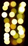 Kreis-bokeh beleuchtet Hintergrund in den goldenen Tönen Lizenzfreies Stockfoto