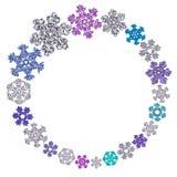 Kreisrahmen gemacht von den verschiedenen Schneeflocken Stockbilder