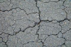 Krekingowa tło tekstura szorstki asfalt Zdjęcia Stock