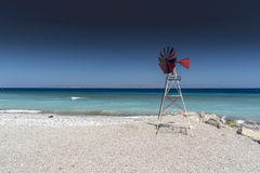 Kremasti Beach and windmill Rhodes Greece.  Royalty Free Stock Photography