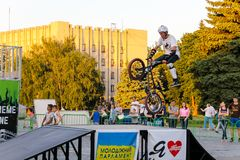 Extreme BMX rider in helmet in skatepark on competition Stock Images