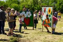 People take photo in photo board with face cutouts for family ph. Kremenchug, Ukraine - June 3, 2017: People take photo in photo board with face cutouts for Royalty Free Stock Photography