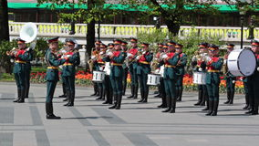 Kremlin brass band. MOSCOW, RUSSIA - MAY 8, 2013: Kremlin brass band at the ceremony laying flowers to the Tomb of the Unknown Soldier in Alexander Garden