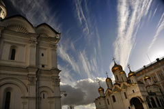 Kremlin Cathedrals against dramatic Clouds in Moscow, Russia. Streaked clouds in an azure sky backdrop two of the Orthodox cathedrals that sit on the grounds of Stock Photography