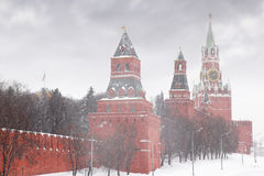 Kremlin chiming clock of the Spasskaya Tower. In Moscow, Russia at wintertime during snowfall stock photo