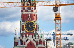 Kremlin clock up view with construction cranes Royalty Free Stock Photography