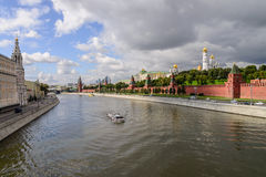 Kremlin embankment at the Moscow center with the kremlin wall, Moskva river and boat on it Royalty Free Stock Photo