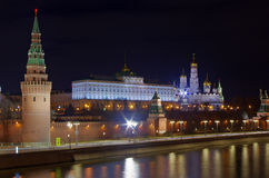 The Kremlin, Kremlin embankment. Kremlin embankment at late spring evening. The lights of the Kremlin are reflected in the water of the Moscow river. Visible Royalty Free Stock Photos