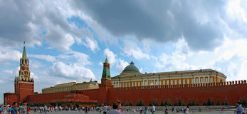 "Kremlin and  mausoleum on Red Square, Moscow. MOSCOW, RUSSIA -€"" JULY 5, 2014: Tourists walk on Red Square  along Spasskaya Tower of the Kremlin and the Royalty Free Stock Image"