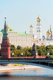 The Kremlin, Moscow. Bolshoy Stone Bridge, Vodovzvodnaya (Sviblova) Tower, the Kremlin Palace and Cathedrals stock images