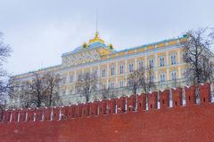 Kremlin Palace of Congresses in the winter. On a background of the Kremlin wall stock images
