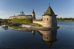 Kremlin of Pskov at dawn. Towers of the fortress and the Christian church on the bank of the river. Pskov, Russia Royalty Free Stock Photos