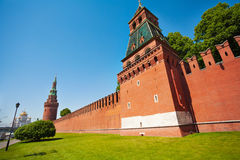 Kremlin red bricks wall view with green trees Stock Images