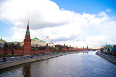 Kremlin. The river and the fortress on the shore against the blue cloudy sky Stock Image