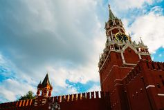 The Kremlin Spasskaya Tower. Kremlin Spasskaya clock tower in the background of the cloudy sky Stock Photography