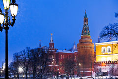 Kremlin tower and Alexander Garden in winter snowing evening, Mo Royalty Free Stock Image