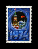 Kremlin tower with red star, red USSR flag, fir-tree, snow for New Year, circa 1973, Stock Photo