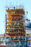 Kremlin tower or steeple or spire with scaffolding on Red Square Stock Photo