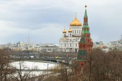 Kremlin towers against the background of the Cathedral of Christ the Savior on a cloudy April day. Moscow. Kremlin towers against the background of the Cathedral royalty free stock photos