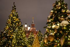 Kremlin towers with Christmas trees during Winter holiday season on Red square in Moscow, Russia.  royalty free stock photos