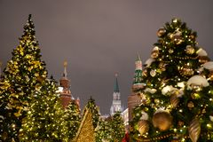 Kremlin towers with Christmas trees during Winter holiday season on Red square in Moscow, Russia.  stock photo