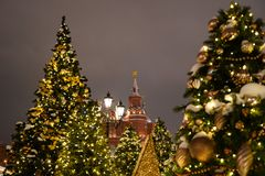 Kremlin towers with Christmas trees during Winter holiday season on Red square in Moscow, Russia.  royalty free stock photo