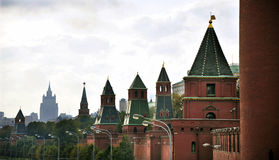 Kremlin Towers Stand Sentry Over Moscow. The red and green battlements of Moscow`s Kremlin line the Moscow River forming an imposing facade Stock Image