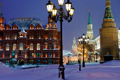 Kremlin towers in winter snowing evening, Moscow. Snow in Moscow - Kremlin towers in winter snowing evening Stock Photo