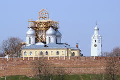 Kremlin of Velikiy Novgorod, Russia. St. Sophia Cathedral and clock tower behind the Kremlin wall royalty free stock image