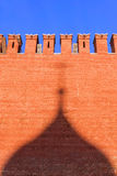 Kremlin wall with a shade from the domes of St. Basil's Cathedra Stock Photography