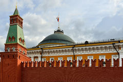 Kremlin wall, tower and Russian flag on Senate building. Moscow Royalty Free Stock Images