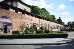The Kremlin wall with towers. The view to the Kremlin wall with the towers and tourist shops stock images