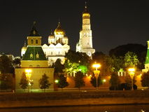 Kremlinl Moscow. Fortress tower dome bell gold wall night lights toller great Stock Images
