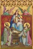 KREMNICA, ΣΛΟΒΑΚΙΑ - 16 ΙΟΥΛΊΟΥ 2017: Η νεογοτθική ζωγραφική στο ξύλινο Madonna, το ST Catherine και το ST επιεικές Στοκ Εικόνα