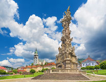 Kremnica - The Safarikovo square the baroque Holy Trinity column by Dionyz Ignac Stanetti, castle and St. Catherine. Kremnica - The Safarikovo square the royalty free stock photo
