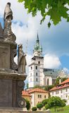 Kremnica - The Safarikovo square and detail of the baroque Holy Trinity column by Dionyz Ignac Stanetti. 1765 - 1772, castle and St. Katherine church stock photo