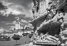 Kremnica - The Safarikovo square and detail of the baroque Holy Trinity column by Dionyz Ignac Stanetti 1765 - 1772. Castle and St. Katherine church stock photography