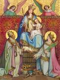 KREMNICA SLOVAKIEN - JULI 16, 2017: Dengotiska målningen av på den wood Madonna, St Catherine och St Clement Royaltyfria Bilder