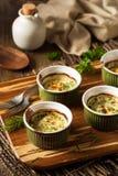 Kremowy jajko Piec w Ramekin zdjęcie stock