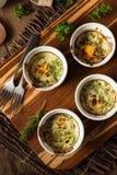 Kremowy jajko Piec w Ramekin zdjęcie royalty free