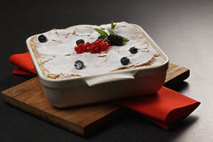 Krempita with berries in baking dish Stock Photography