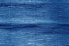 Krepdeszynowy papier z plama skutkiem w marynarki wojennej błękita kolorze Zdjęcia Royalty Free