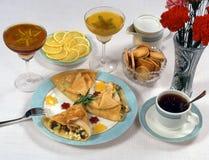 Krepps und Imbiß für Tee Stockfoto