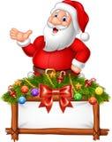 Kreskówka Święty Mikołaj pozuje z dekorującym sztandarem ilustracji