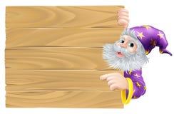 Kreskówka czarownik wskazuje znaka Zdjęcie Stock