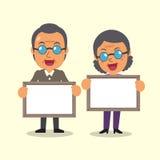 Kreskówka stary człowiek i starej kobiety mienie wsiadamy dla prezentaci Zdjęcie Stock